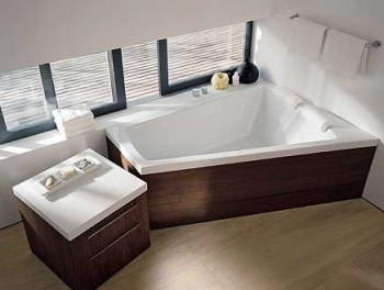 une salle de bain design gr ce une baignoire d angle. Black Bedroom Furniture Sets. Home Design Ideas